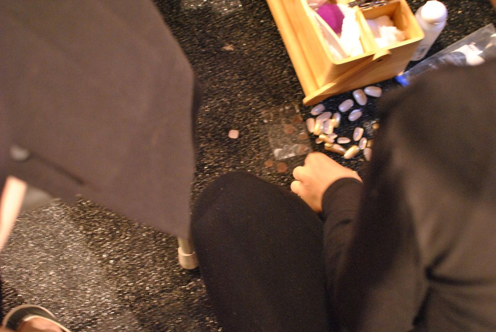 <p>The nail tips on the floor looked like confetti.</p>