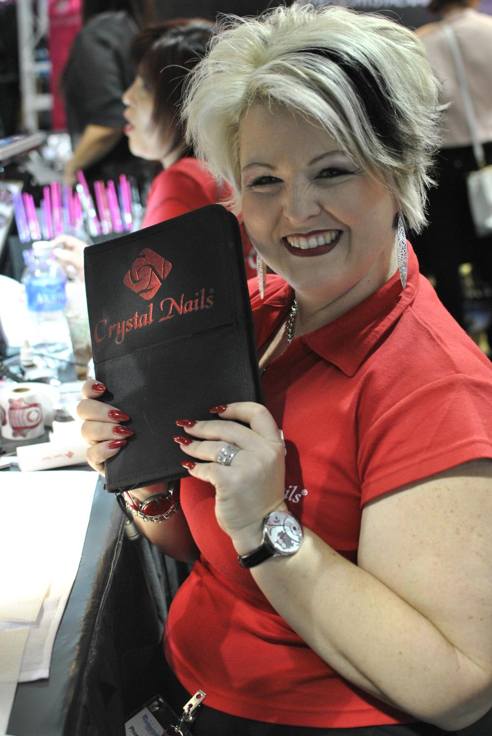 <p>Crystal Nails educator Phoenix Van Dyke holds up her favorite brush organizer.</p>