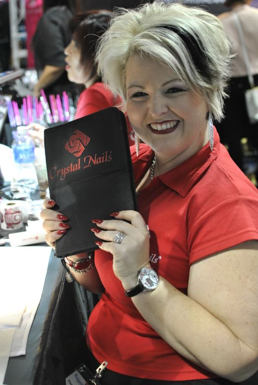 <p>Crystal Nails educator Phoenix Van Dyke holds up her favorite brush organizer.</p>