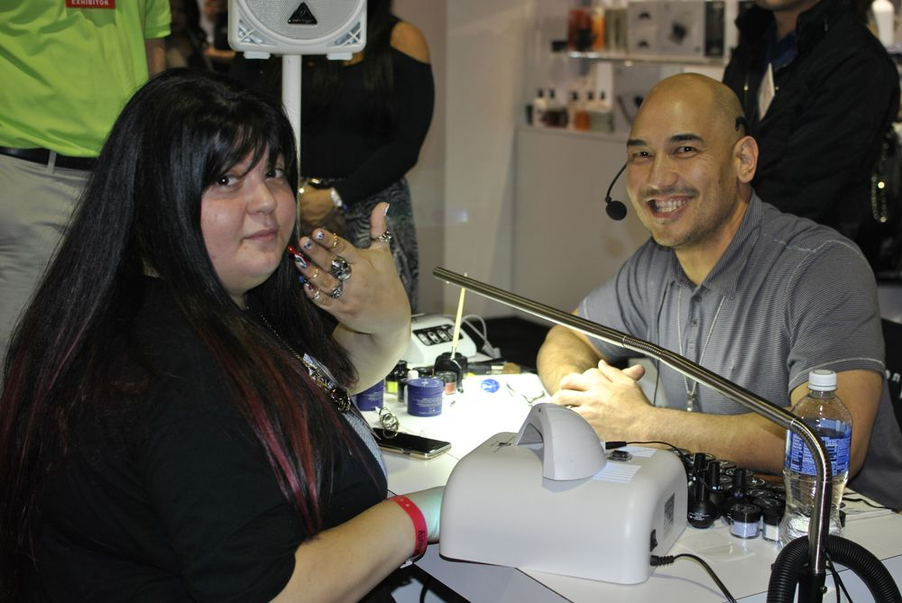 <p>NTNA first runner-up Lexi Martone and Young Nails' Greg Salo</p>
