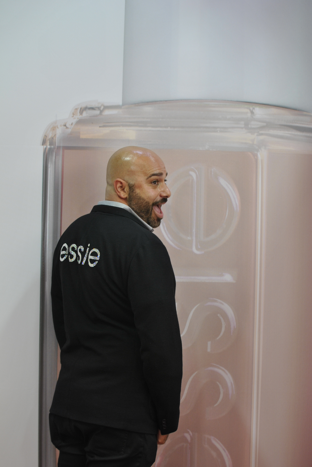 <p>Essie's Gino Trunzo shows off his blinged out Essie jacekt.</p>