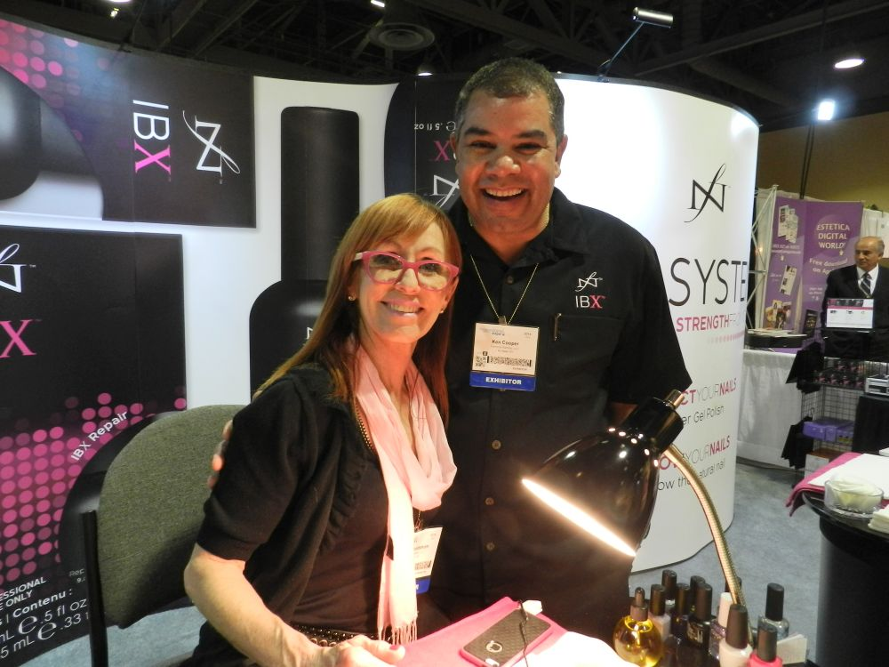 <p>Famous Names CEO Linda Nordstrom demonstrated IBX at their booth, while Ken Cooper looked on.&nbsp;</p>