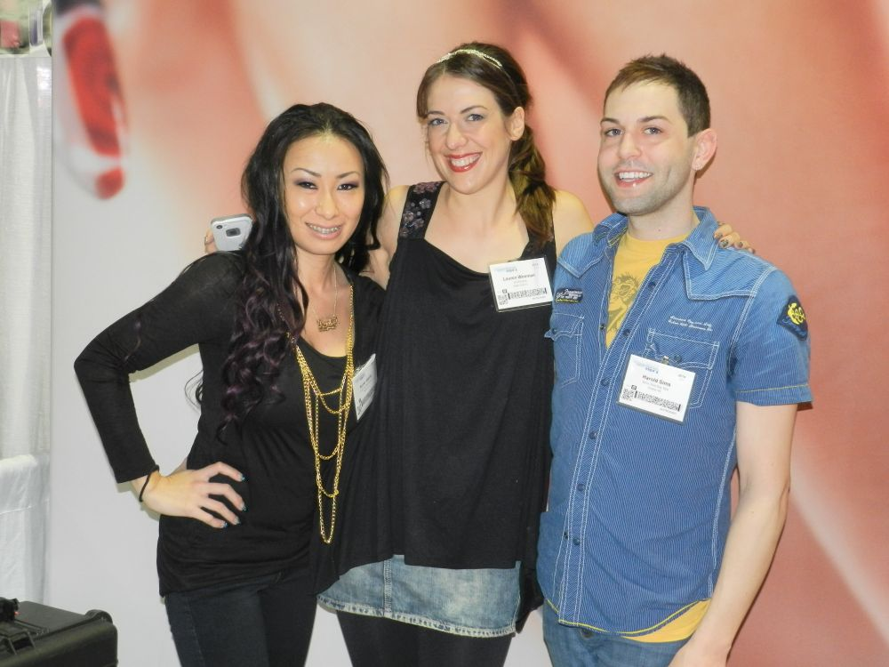 <p>The Next Top Nail Artist top three gathered in our booth for a photo op before their final competition. Left to right: Ryoko Garcia, Lauren Wireman, and Buddy Sims.</p>