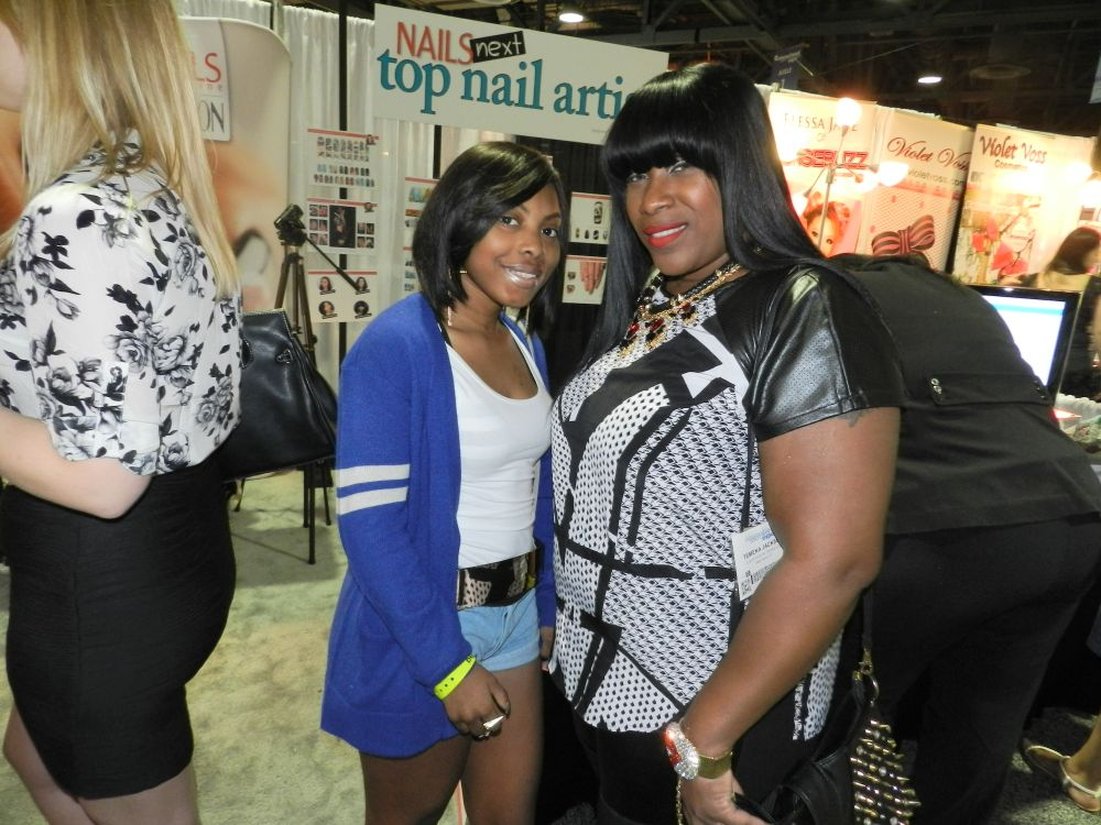 <p>Next Top Nail Artist competitor Temeka Jackson (right) stopped by our booth.</p>