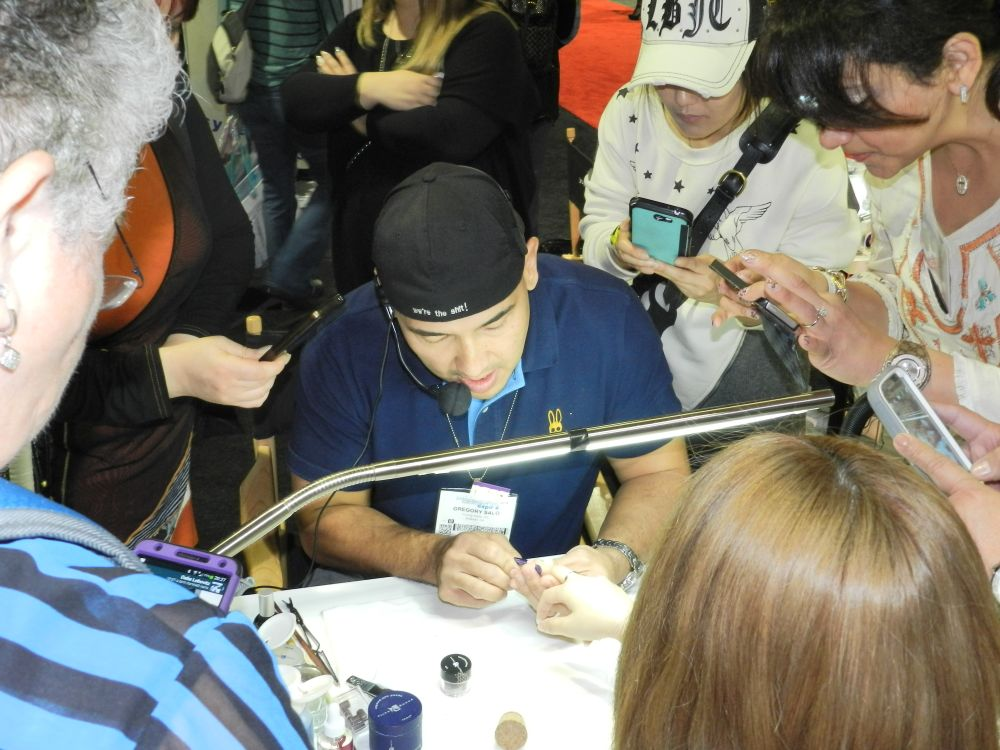 <p>Greg Salo always has a crowd around him while demoing at the Young Nails booth.</p>