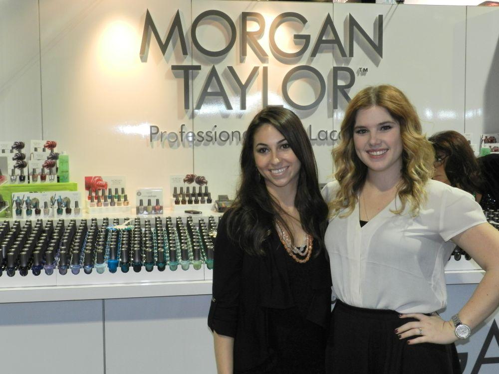 <p>Morgan Haile and Taylor Daniel at their namesake booth.</p>