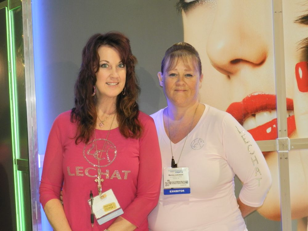 <p>LeChat's Yvette Pitt and Marica Johnson wear beautiful nails and smiles at their booth. &nbsp;</p>