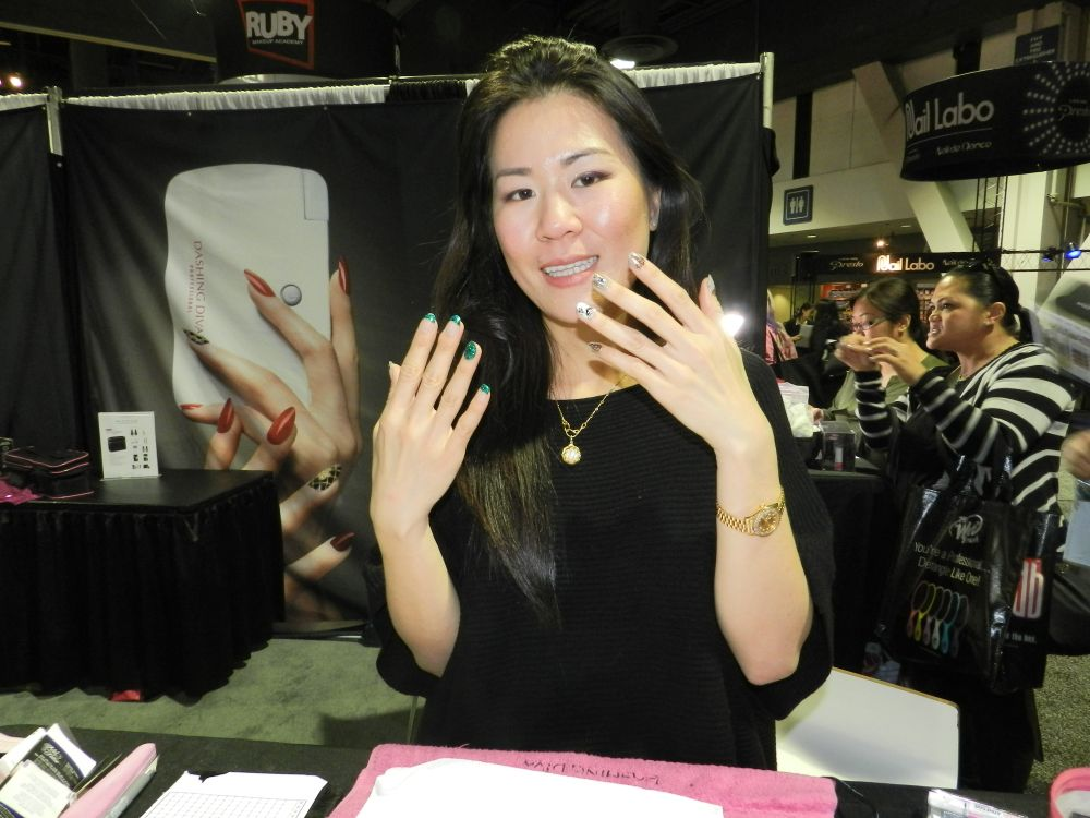<p>Ashley Van flashes her dazzling digits at the Dashing Diva booth.</p>