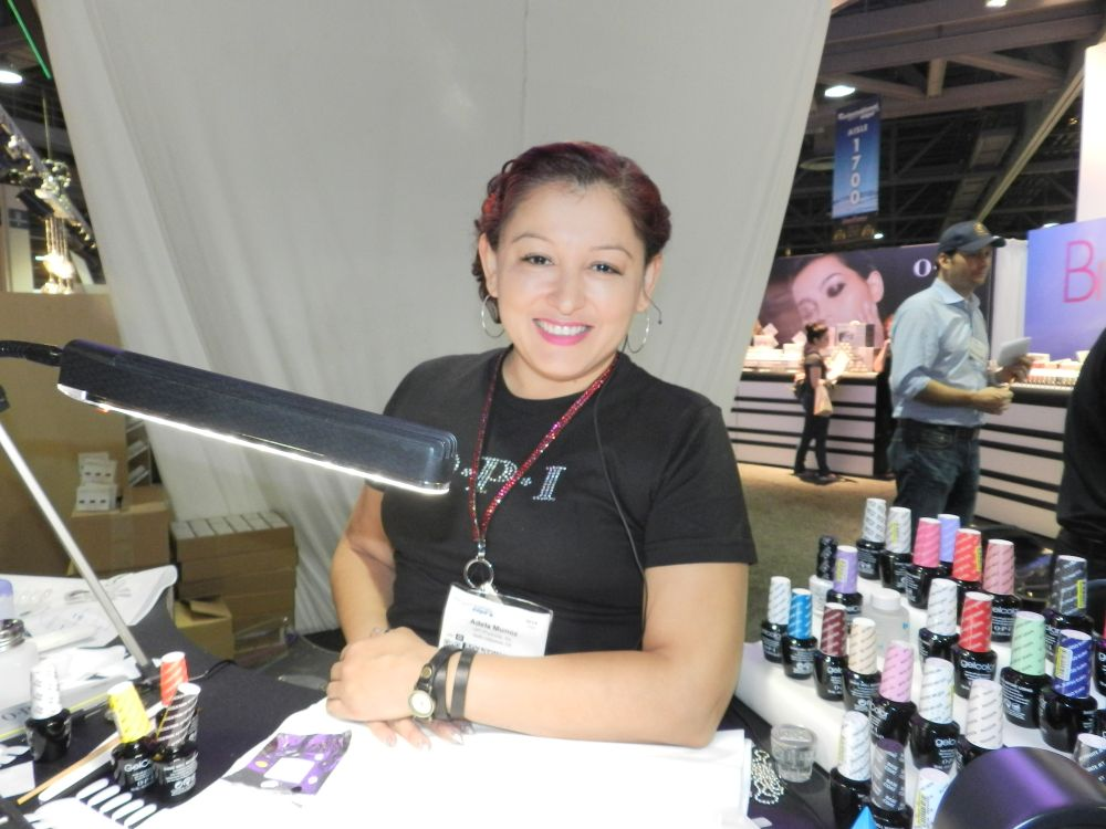 <p>We are always happy to see OPI's Adela Munoz demoing on the show floor.</p>