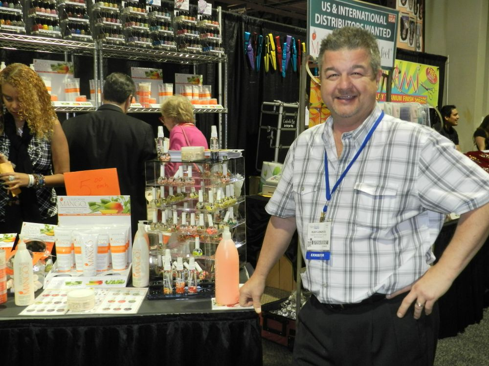 <p>Rudy Lenzkes showed off his wide array of products at the California Mango booth.</p>