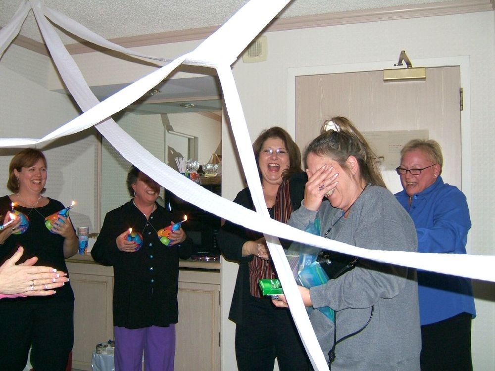<p>Vicki helping throw a 50th surprise party for long-time friend Debbie Doerlamm at America's Beauty Show in Chicago, 2005</p>