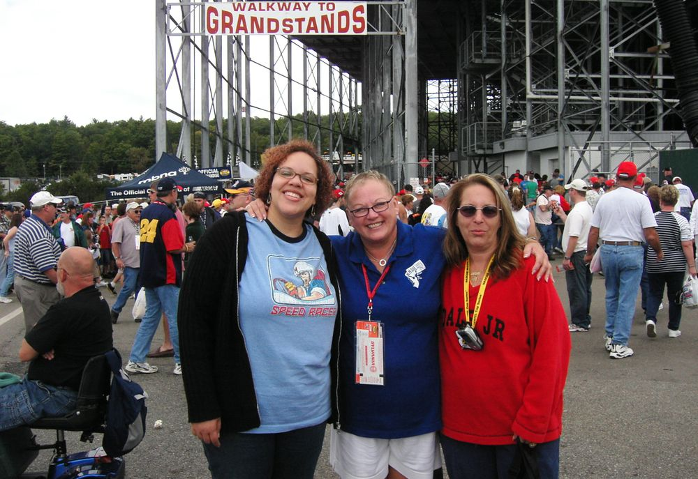 <p>Michelle Phoenix, Vicki, and Debbie Doerlamm at the New Hampshire Speedway in 2004</p>