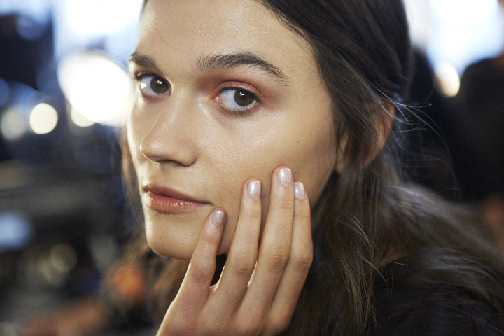<p>Apply one coat of Essie Like Linen, avoiding the lunula, then apply one coat of Au Natural over the entire nail to copy the look at Altuzarra.</p>