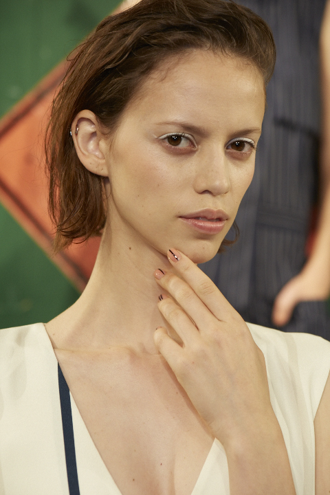 "<p>Rita Remark created a sheer pink base that was like ""lip gloss for the nails"" at Ji Oh's show, using Essie Resort Fling and Sugar Daddy.</p>"