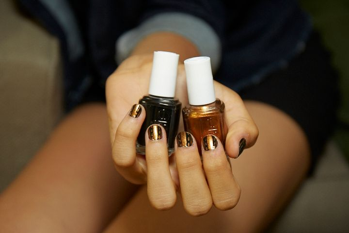 <p>Use Essie Licorice, a vetical stripe of Leggy Legend, dots and dashes of Leggy Legend, and Gel.Setter top coat to recreate the look at Sophie Theallet.</p>