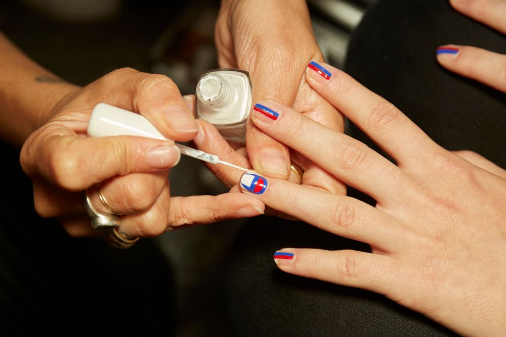 <p>The Kith Spring 2018 show was inspired by the modern tomboy, and Essie's Champion-inspired nail art fit the theme.</p>