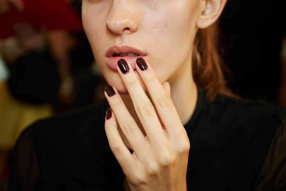 <p>Essie Wicked was used on hands at Monique Lhuillier. <strong>PHOTO CREDIT: Sam Kim&nbsp;for essie</strong></p>
