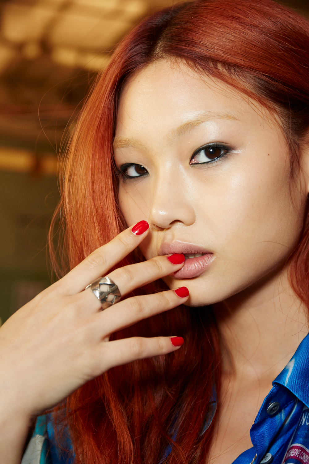 """<p>Julie Kandalec created a """"tough"""" nail look at Rag &amp; Bone by using a custom mix of Essie A-List and Really Red to match the red in the collection.&nbsp;PHOTO CREDIT: Sam Kim&nbsp;for essie</p>"""