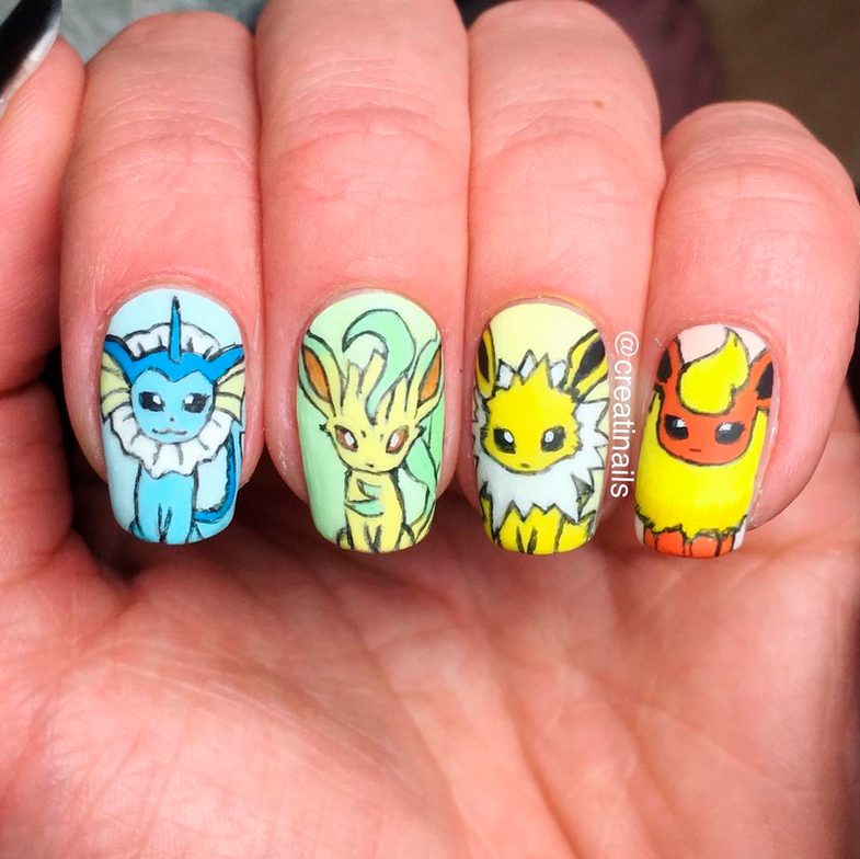 "<p>Eevee evolution nails (vaporeon, leafeon, jolteon, and eevee nail art) by <a href=""https://www.instagram.com/creatinails/"">@creatinails<br /></a></p>"