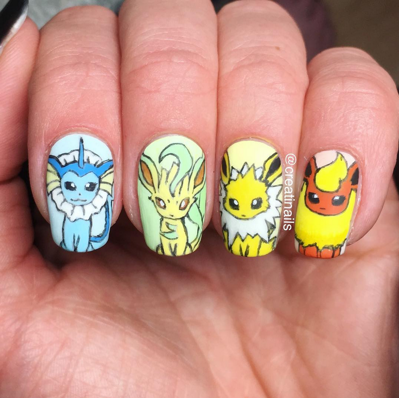 """<p>Eevee evolution nails (vaporeon, leafeon, jolteon, and eevee nail art) by <a href=""""https://www.instagram.com/creatinails/"""">@creatinails<br /></a></p>"""