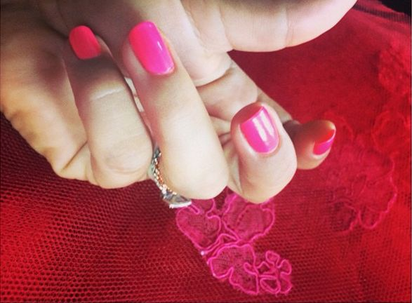 <p>Ashlie Johnson used Chanel Pink Tonic to polish Kaley Cuoco-Sweeting's nails for the Emmys to match her vibrant colored gown.&nbsp;</p>