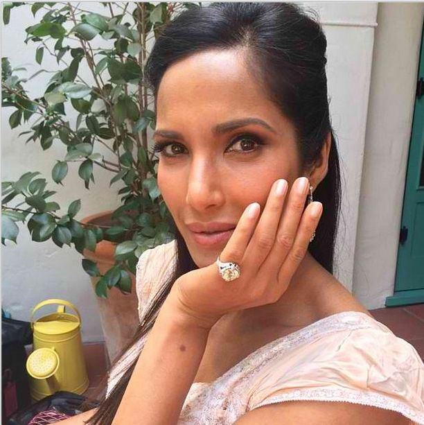 <p>Padma Lakshmi shows off her nails in Essie's Imported Bubbly at the Emmys. Celebrity nail artist Julie Kandalec did the star's nude nails. Image via @julieknailsnyc.&nbsp;</p>