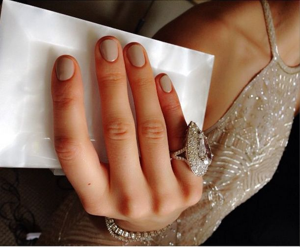 "<p>Michelle Saunders painted Taylor Schilling's nails with Essie Cocktails and Coconuts to get the perfect ""opaque nude."" Image via @_michellesaunders.</p>"