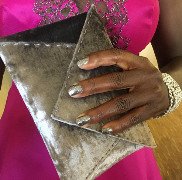 <p>Julie Kandalec layered Essie Licorice underneath two coats of Set in Stones for Viola Davis' Emmy nails.</p>