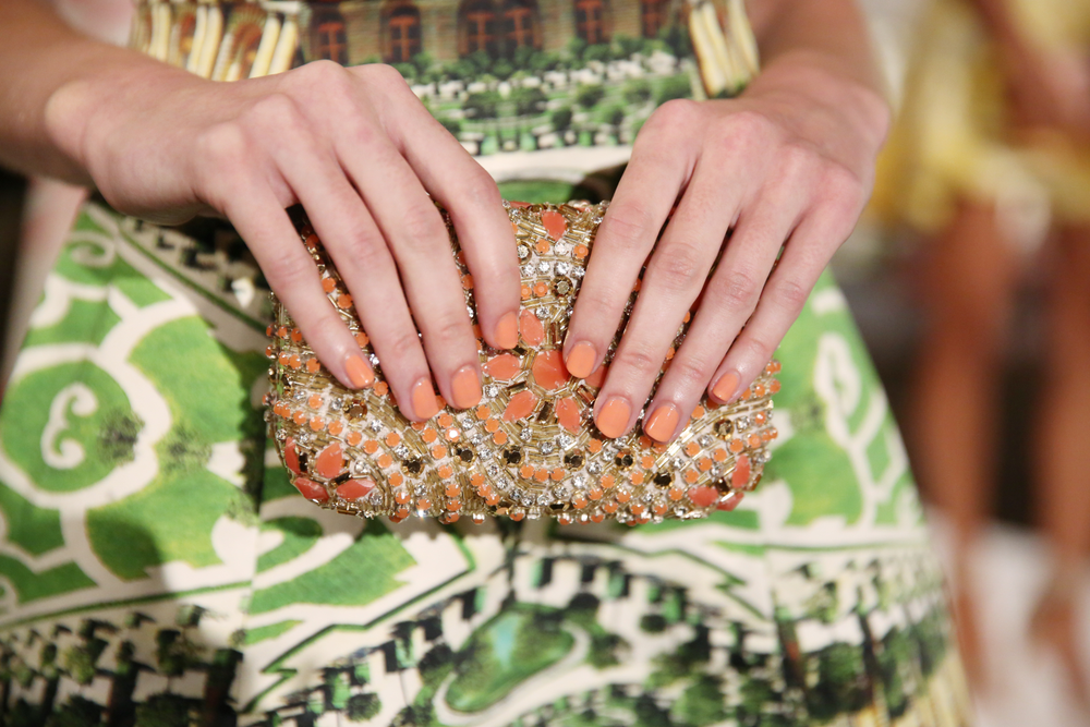 <p>Inspired by colors seen throughout the fabrics, Rita Remark for Essie crea<strong>ted</strong> three different nail options to directly coincide with the Alice + Olivia collection. Photo courtesy of Essie.&nbsp;</p>