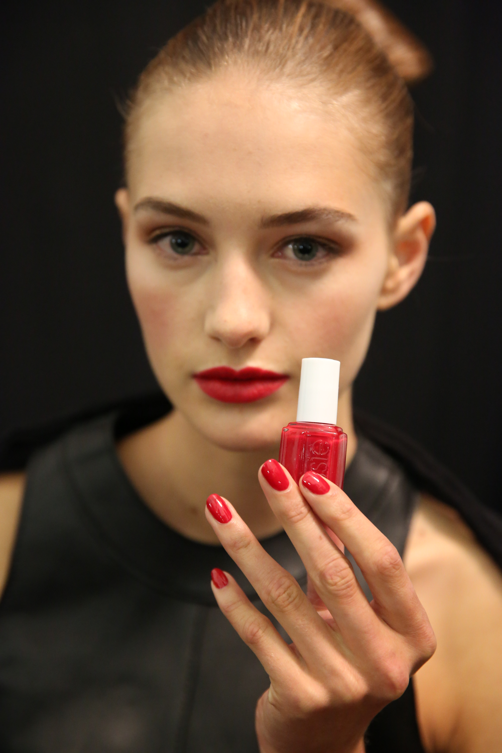 <p>Michelle Saunders for Essie created a classic spring red nail by using two coats of A-List for Carolina Herrera. Photo courtesy of Essie.</p>