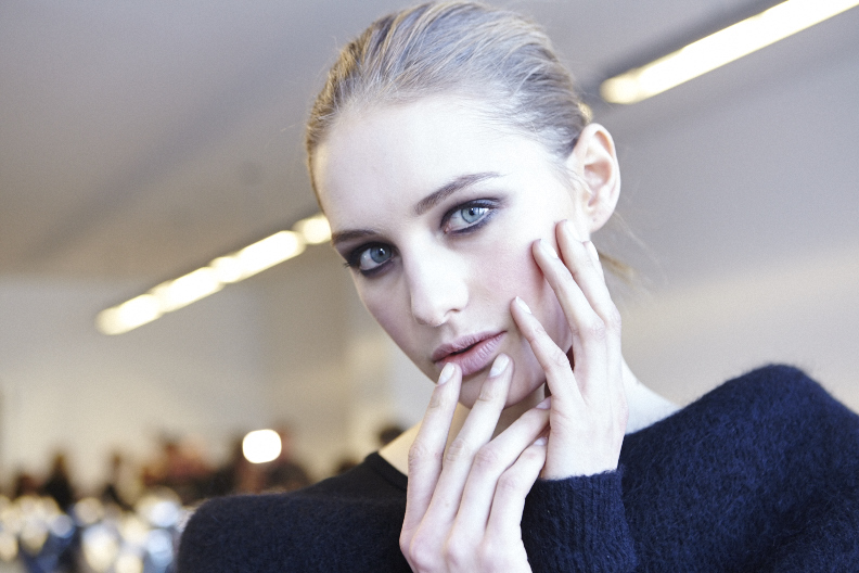 <p>Michelle Saunders opted for a modern take on the half-moon mani for DVF's 1940's-inspired collection.</p>