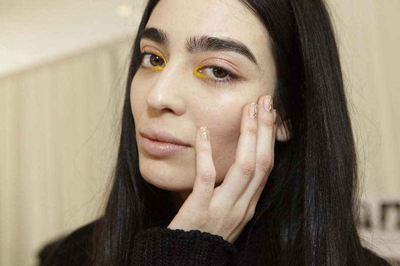 <p>Julie Kandalec for Essie created a matte gold nugget look for Delpozo.</p>
