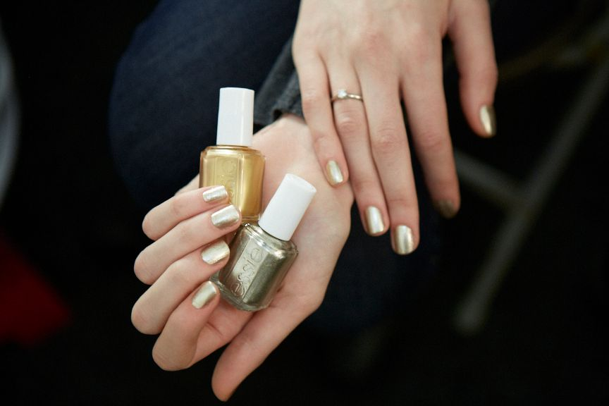 <p>Julie Kandalec created this distressed gold nail using Essie Shifting Power and Jiggle Hi, Jiggle Low for Naeem Khan.</p>