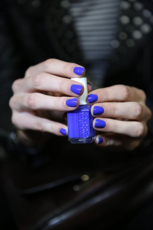 <p>To complement the strong, androgynous aesthetic, Julie Kandalec for Essie created a vibrant blue nail by using two coats of Butler Please on both the hands and feet.&nbsp;Photo courtesy of Essie.&nbsp;</p>