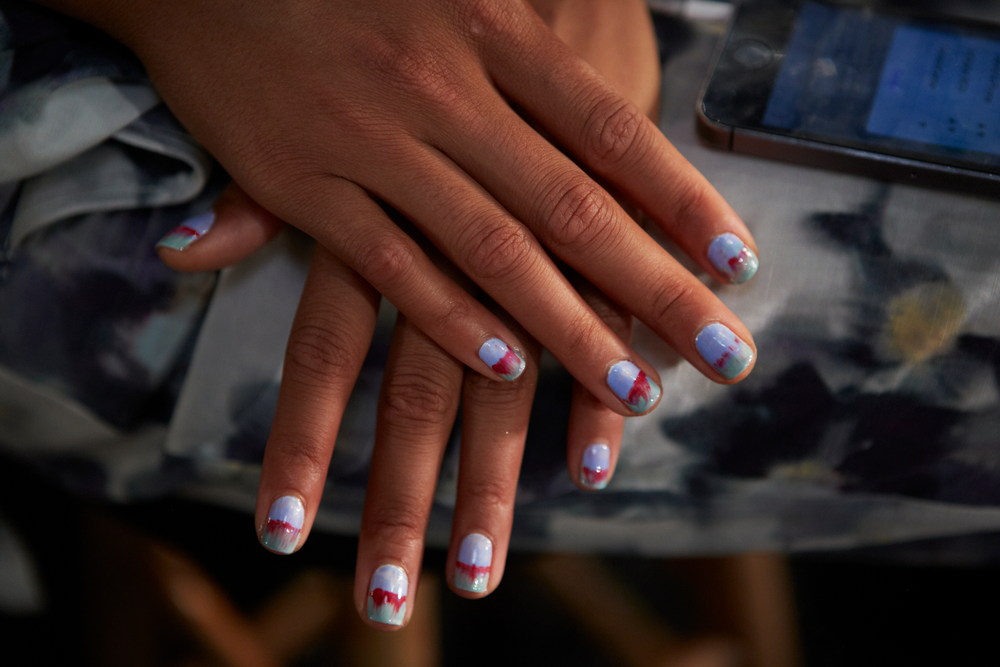 <p>To get the look at Rebecca Minkoff, use one coat of Essie Blanc, followed by one coat of Bikini So Teeny on half of the nail. Add a coat of Turquoise &amp; Caicos to the remaining half, slightly overlapping in the middle. Dip a striping brush in Lollipop and draw a thin horizontal fault line across each nail. Photo courtesy of Essie.&nbsp;</p>
