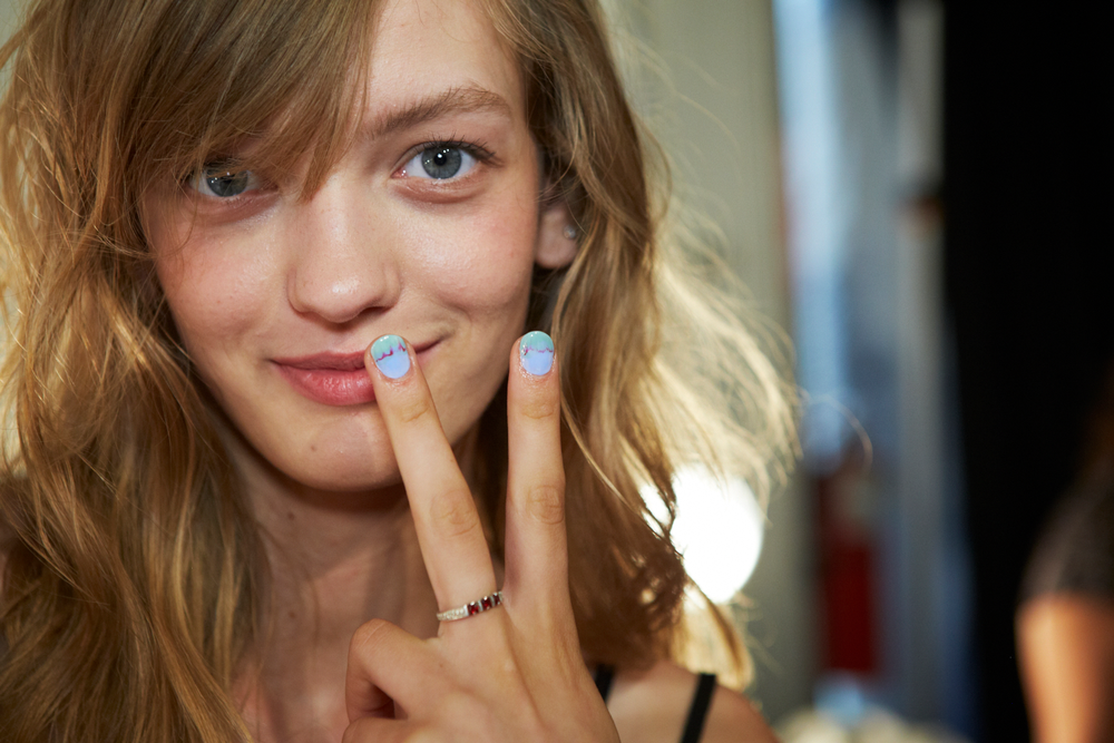 <p>Inspired by Rebecca Minkoff&rsquo;s unique 3D prints and color scheme, Michelle Saunders for Essie created freehand watercolor nail art for the hands. Similar to a watercolor painting, each nail serves as a unique piece of art that intertwines with the collection.Photo courtesy of Essie.&nbsp;</p>