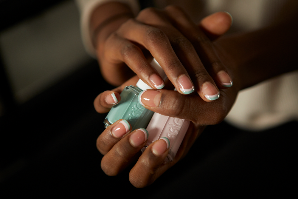<p>Inspired by the island vibe of Sophie Theallet&rsquo;s Spring/Summer 2015 collection, Julie Kandalec for Essie created a negative space double French tip. Photo courtesy of Essie.&nbsp;&nbsp;</p>