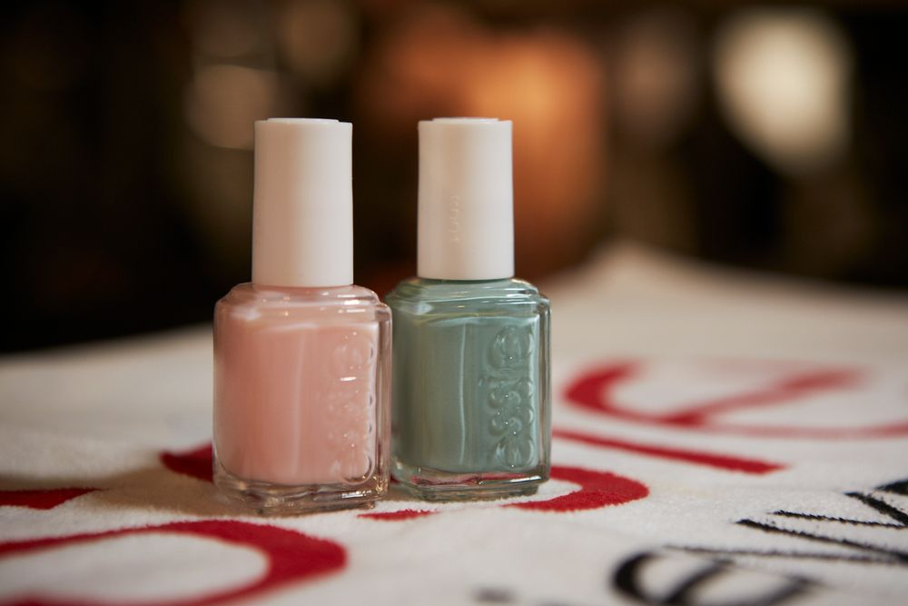 <p>Brush a wide arc across the tip with two layers of Turquoise and Caicos. Cover half the arc with Fiji to get the look from Sophie Theallet. Photo courtesy of Essie.&nbsp;</p>