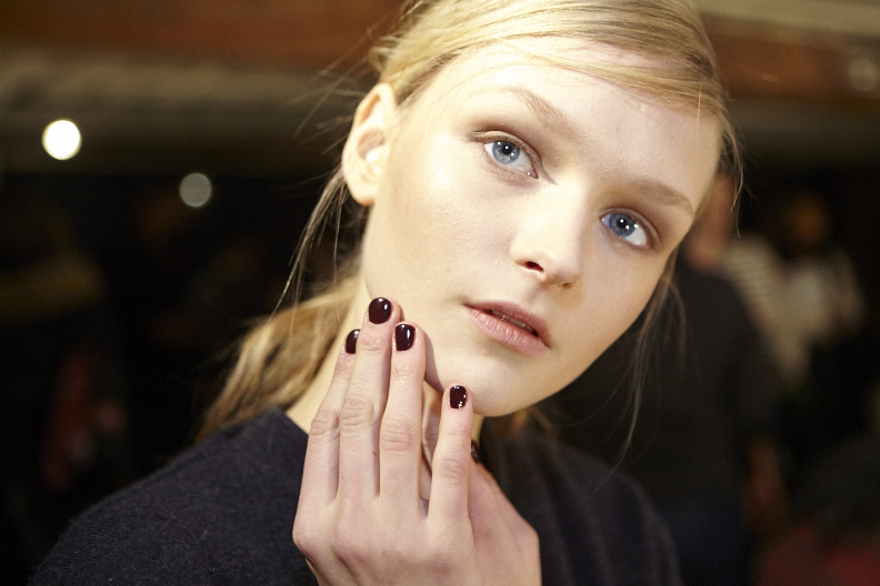 <p>Inspired by the Adirondack, Veronica Beard's collection was ful of earth tones, which Essie complemented with mahogany nails.</p>