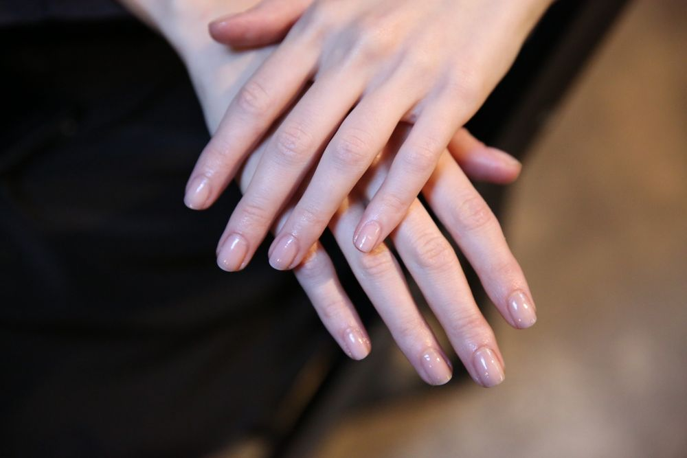 <p>To complement the low key beach vibe at Yigal Azrouel, Rita Remark for Essie created a sheer sandy beige nail. Photo courtesy of Essie.&nbsp;</p>