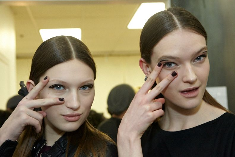 <p>The Edwardian feel of Yigal Azrouel's show inspired Essie's Rita Remark to opt for a plum nail</p>
