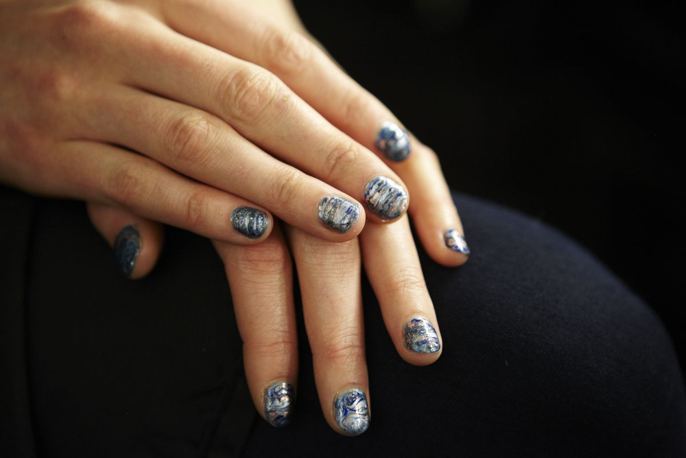 <p>NAIL ART: For the Rebecca Minkoff show, each Essie shade -- As Gold As It Gets, Penny Talk, Go Overboard, Blue Rhapsody, and Aruba Blue -- were applied in small dots, then swirled together with a thin paintbrush.</p>