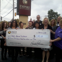 """Students at Empire Beauty School in Framingham, Mass., present their adopted shelter """"Voices..."""