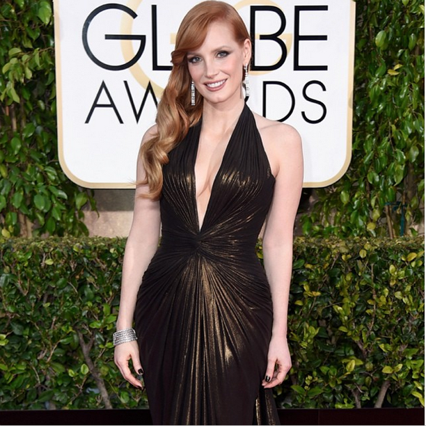 <p>Angel Williams used Essie Licorice with a thin layer of Penny Talk on top for nominee Jessica Chastain. Image via @essiepolish.</p>