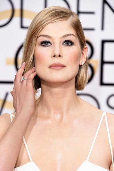 <p>Passion from OPI adorned Golden Glove nominee Rosamund Pike's nails done by April Foreman. Image via The Wall Group.</p>