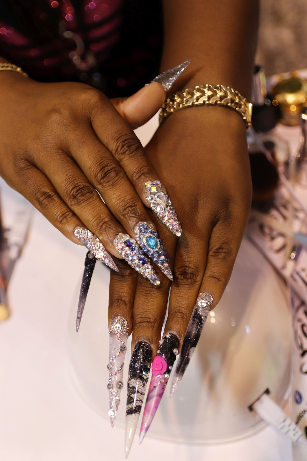 <p>Gelli Co. educator had blinged out nails.</p>