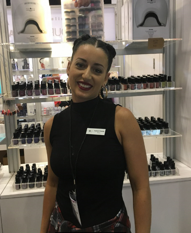 <p>Stephanie Fountain demoed a glitter ombre at the Young Nails booth</p>