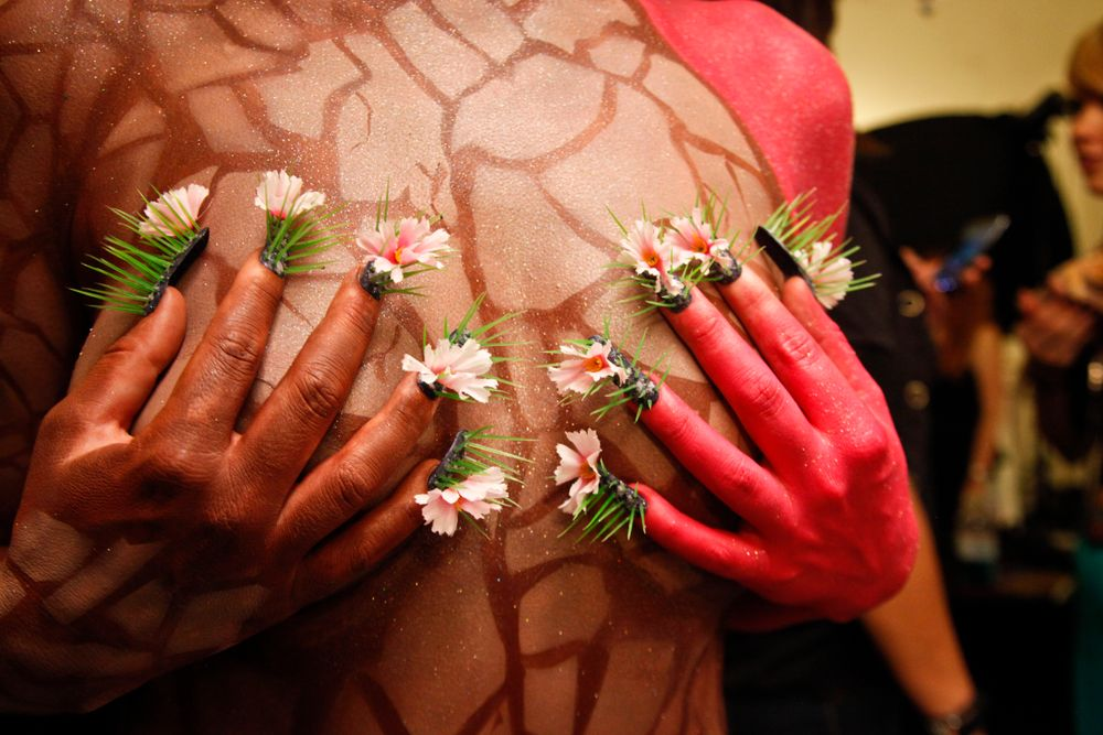 <p>Headliners Salon: Yavenue drilled through the nail to keep the spikes in place for the blooming cactus, angled as she'd envisioned. She used polish and acrylic powder to create a mossy look under the spikes for a more life-like look.</p>