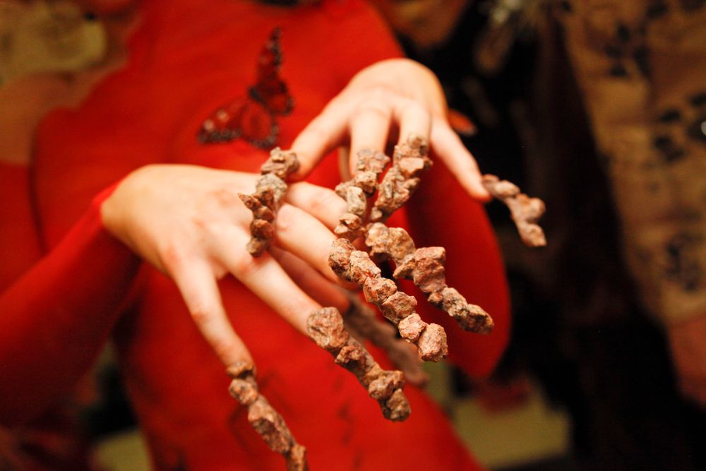 <p>Headliners Salon: Yavenue used actual pebbles and rocks on the nail, which became heavier on the model as the night progressed.</p>