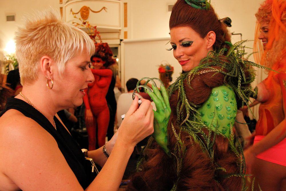 <p>Nail tech Joy Yavenue touches up a model's nails before showtime.</p>